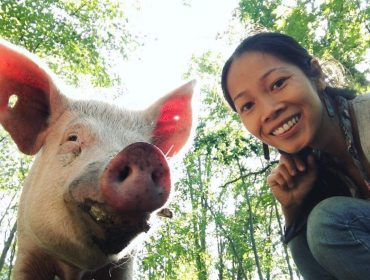 Picture of Sol Criations member with a pig